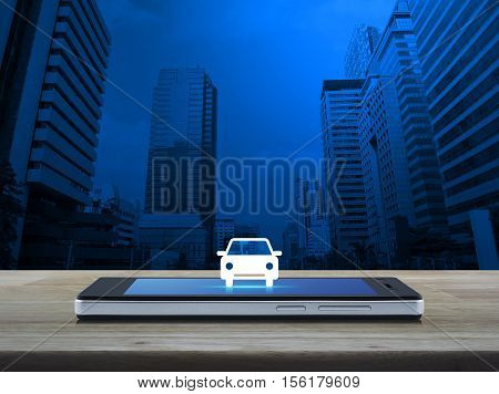 Car front view flat icon on modern smart phone screen on wooden table over city tower background Business service car concept