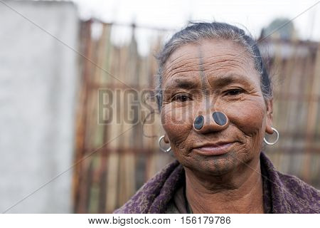 ZIRO, ARUNACHAL PRADESH/INDIA - DECEMBER 13, 2013: Apatani tribal woman, with nose plugs, The Apatani are a tribal group of people living in the Ziro valley in Arunachal Pradesh, India.