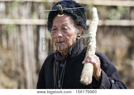 ZIRO, ARUNACHAL PRADESH/INDIA - DECEMBER 14, 2013: Man from the Apatani tribe. The Apatani are a tribal group of people living in the Ziro valley in Arunachal Pradesh, India.