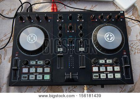 black dj mixer controller Black dj mixer controller. Closeup view.