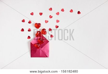valentine's day white background red envelope with lots of transparent sweet hearts and confetti