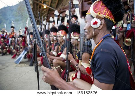 KOHIMA, NAGALAND/INDIA - DECEMBER 1, 2013: Tribesmen of Nagaland show their traditional tribal costumes at the annual Hornbill festival. The Hornbill is also known as the Festival of Festivals'.