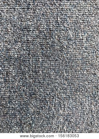 Grey carpet background texture, weft and pattern of the weave in the pile
