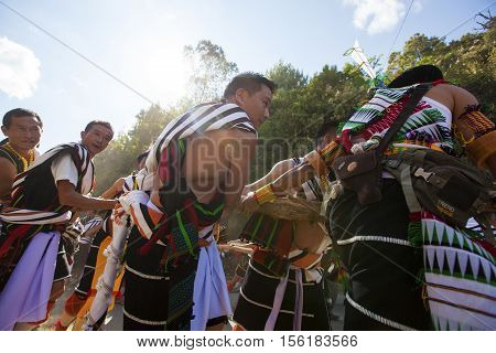 VISWEMA, NAGALAND/INDIA - DECEMBER 2, 2013: Angami tribals in traditional attire gathers at Viswema village for the Stone pulling ceremony. This is an ancient Angami tradition still carried out today.