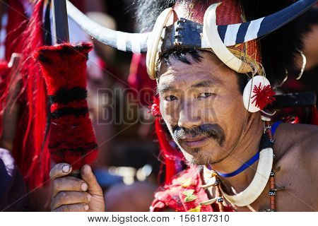 KOHIMA, NAGALAND/INDIA - DECEMBER 4, 2013: Tribes people of Nagaland show their traditional tribal costumes at the annual Hornbill festival. The Hornbill is also known as the Festival of Festivals'.
