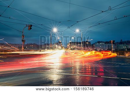 Light trails on the crossroad during rainy night in the city. Prague Czech Republic.