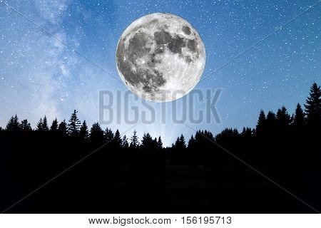 Super Moon. A view of the stars of the Milky Way with a silhouette of a pine trees forest in the mountain. poster