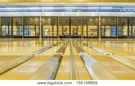 DUBAI UAE - NOVEMBER 7 2016: Interior of metro station in Dubai. Metro as world's longest fully automated metro network (75 km). The Metro is one of most effective way to explore and discover Dubai City.