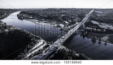 Aerial View Texas Hill Country at 360 bridge or Pennybacker Bridge along the Colorado River in a monochrome finish