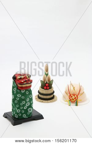 Lion dance(Shishimai), a round rice cake(Kagamimochi), and bamboo(kadomatsu) on white background. New year's image.