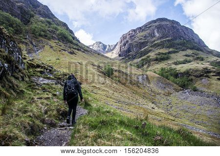 Glen Coe Highlands scotland girl hiking in nature uphill crossing for panorama view 2