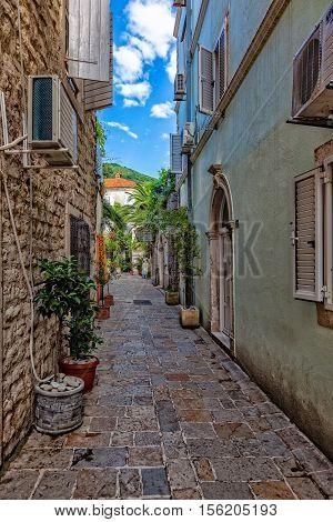 BUDVA, MONTENEGRO - JULY 18: Picturesque narrow street, on July 18, 2014 in Budva, Montenegro. Budva among the oldest urban settlements of the Adriatic coast, a UNESCO World Heritage Site.