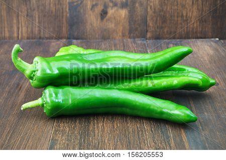 Organic long green peppers Green vegetables. Organic long green peppers on wooden background selective focus horizontal