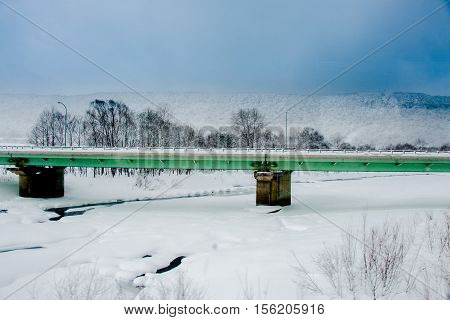 Green Iron Bridge Cover By Snow In Winter.