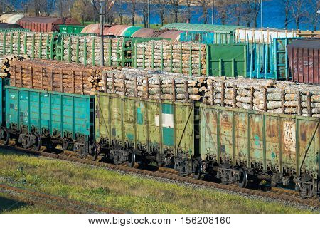 cars with logs at the railway station. Saint-Petersburg, Russia, 2016