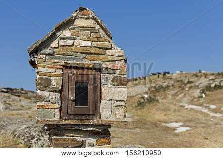 Miniature Roadside Chapel with Goats in the Background