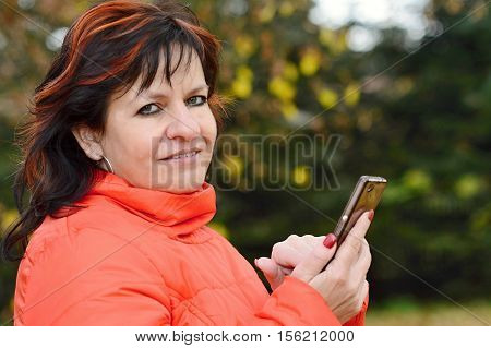 Woman Holding The Mobile Phone