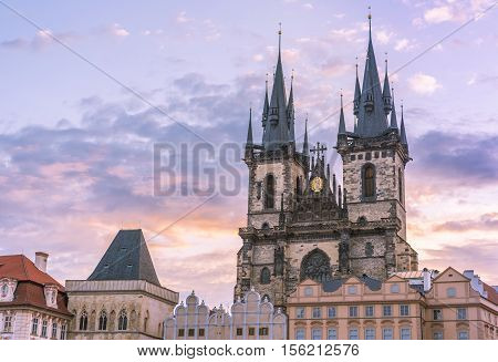 Prague famous cathedral under morning sky - Church of our Lady before Tyn from Prague Old Town Square at sunrise under a beautiful sky