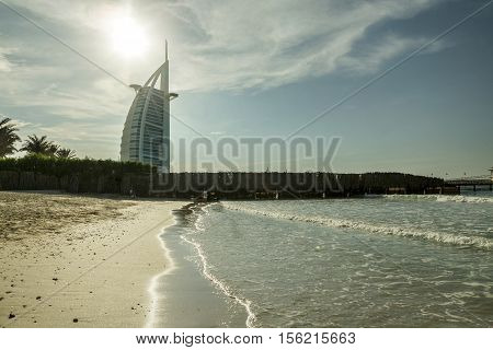 DUBAI UAE - NOVEMBER 9 2016: Burj Al Arab hotel on Jumeirah beach in Dubai. Modern architecture luxury beach resort summer vacation and tourism concept. View from boat. Al Arab. Dubai.