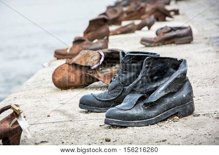 Shoes monument on the Danube bank is a memorial in Budapest Hungary. Place of reverence. Cultural heritage. Symbolic artistic object.