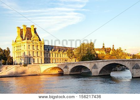 View of Carrousel Bridge and the palace of Louvre, Paris, France