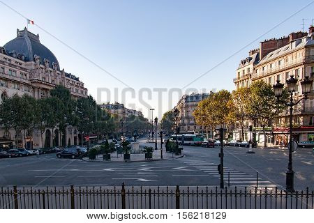 PARIS, FRANCE, APRIL 26, 2016. San Agustin square at sunset.  On the left View of the Cercle national des Armees de Terre de Ner et de L'air (National Circle of Army, Navy and Air Force). Army Officers Residence
