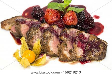 Peking duck with berries on a white background
