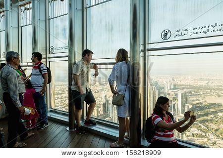 DUBAI UAE - NOVEMBER 8 2016: Tourists on Burj Khalifa tower. people at the top the observation deck of the highest building in the world Burj al Khalifa