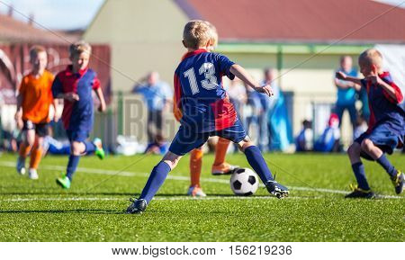 Boys Play Football; Children kicking Soccer Ball; Football Tournament for Youth Sports Teams
