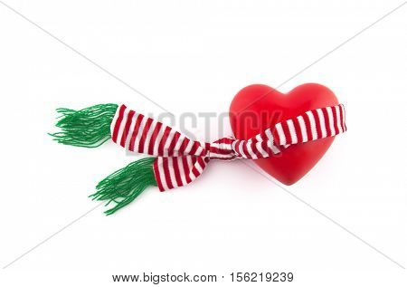 Red heart wrapped in a scarf
