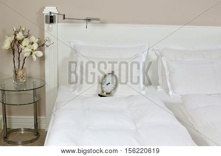 Alarm Clock On A Bed