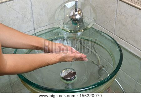 Rinsing Hands In Bathroom