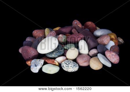 multicolored beach pebbles isolated on black background poster