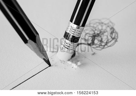 Close Up Of A Pencil Eraser Removing A Crooked Line And The Close Up Of A Sharpened Pencil Writing A