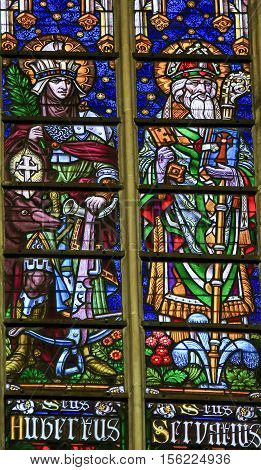 MECHELEN BELGIUM - JANUARY 31 2015: Stained Glass window depicting Saints Hubertus and Servatus in the Cathedral of Saint Rumboldt in Mechelen Belgium.