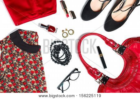 Female clothes and look essentials - silk blouse, red skirt, black high heels, red leather bag, red lipstick, glasses