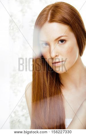 beauty young redhead woman with red flying hair, funny ginger fresh spa girl isolated on white background close up, nude makeup