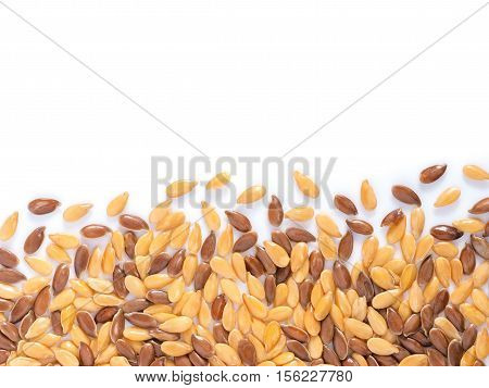 Golden and brown flax seed with copy space. Isolated one edge. Top view or flat lay
