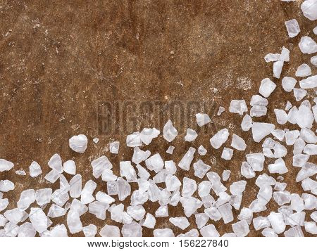 coarse salt closeup on baking parchment background with copy space. Top view or flat lay.