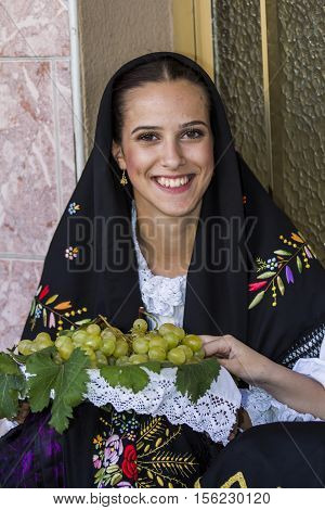 QUARTU S.E. ITALY - September 17, 2016: Parade of Sardinian costumes and floats for the grape festival in honor of the celebration of St. Helena. - Sardinia - portrait of a beautiful girl in traditional Sardinian costume