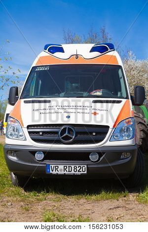 GRIMMEN / GERMANY - MAY 5 2016: german ambulance vehicle stands on tractor show in grimmen / germany at may 5 2016.
