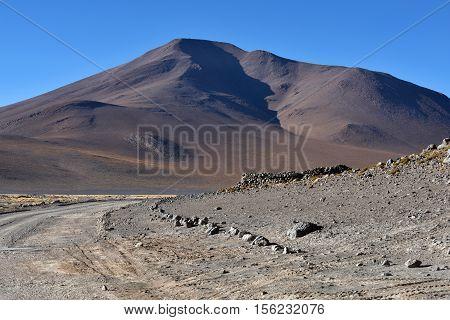 Dusty road in Eduardo Avaroa Andean Fauna National Reserve in Bolivia South America