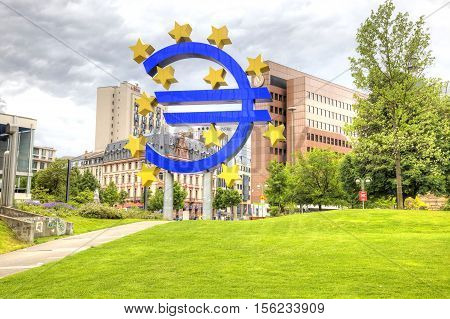 FRANKFURT AM MAIN GERMANY - May 07.2014: Sculpture as a logotype of Euro is set in a public garden opposite the European central bank