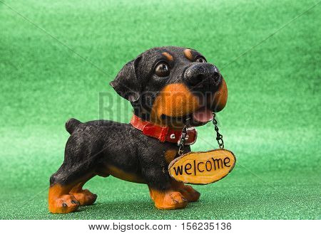 dog with the inscription Welcome to the green background
