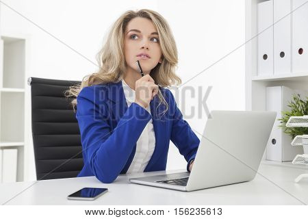 Businesswoman In Blue Blazer Is Composing A Document