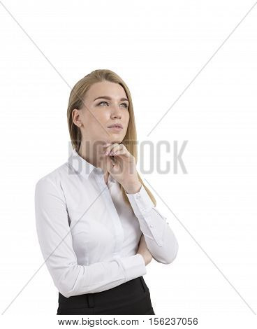 Side view of a thinking blond businesswoman standing in a blouse with her hand near the chin. Isolated