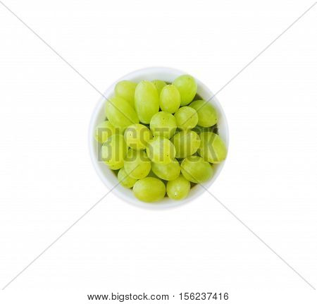 Grapes in a ceramic bowl isolated on white background. Green grapes Kish Mish. Top view.