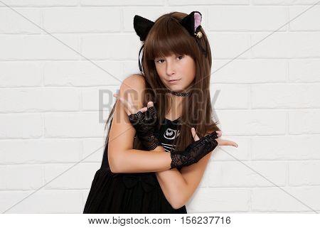 Portrait of cute teen girl disguised as a kitten.