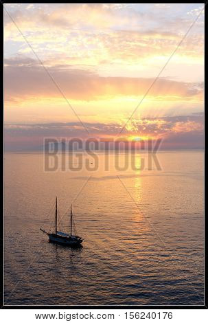 The sun goes down by the bay of Salerno, Italy.
