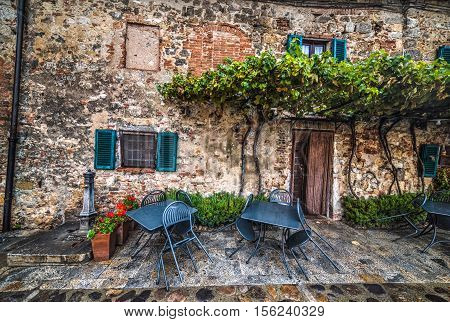 quaint corner with table and chairs in Monteriggioni Italy